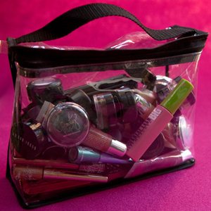 unorganized makeup in a clear makeup bag